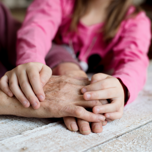 Hands of children and elderly